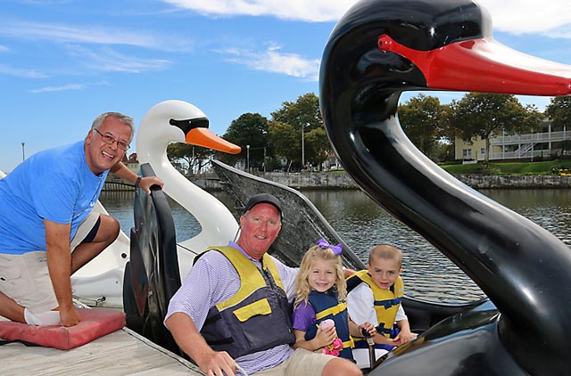 Neil Zarpella helps Bill Looney of Avon with Ava and Jake at the pedal boat rides on Wesley Lake in Asbury Park. The business will operate on the weekends until the end of October.