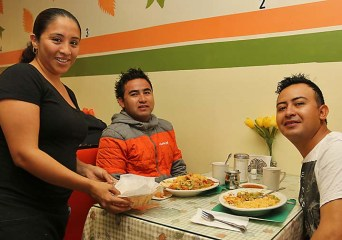 Elizabeth Hernandez waited on Antonio Meza and Ivan Martinez, both of Bradley Beach at the Bradley Cafe.