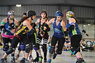 Avon resident Jessica O'Hanlon (fourth from right) is a member of the Red Bank Roller Vixens. Photo by John Keoni for the Red Bank Roller Vixens.