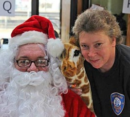 Police Sgt. Connie Breech with a well-known figure. From facebook.com/Asburyparktoycentral