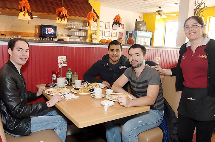 Enjoying lunch at Sweetpepper in Bradley Beach were Carlos Coello-Beseke, Alex Cannon and Richard Arndt, all of Bradley Beach. Waiting on them was Daiana Padilla, business owner.
