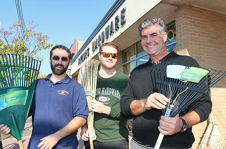 Got leaves? Taylor Hardware on Main Street in Belmar has the solution to a variety of home needs. Pictured at the store are Steve Frye, manager; Jake Connor and Joe Connor, owner.