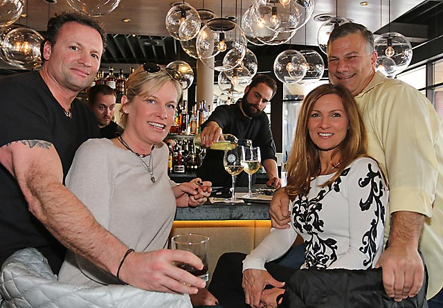Enjoying themselves at the benefit at Taka were Keith Elphick, Asbury Park; Patti Harvey, Interlaken; Jackie Hurley, Ocean Township and Keith Ortner, Asbury Park. Bartender Patrick Mazzola was serving them.