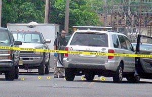 Evidence markers dot the scene around the silver sport utility vehicle of Neptune Police Sgt. Phillip Seidle on Sewall Avenue at Ridge Avenue in Asbury Park June 17. He is charged with murdering his ex-wife, Tamara Seidle.
