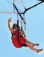 Coaster Photos - Neptune Midtown Community Elementary School Principal Arlene Rogo waved to students from her parasail over the Ocean Grove beach Monday morning.