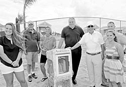 Little Free Library stations have been set up in Deal. Pictured with one of them are (from left) Taylor Sniffen, Deal Casino staffer; retired Boround Administrator James Rogers; Deal Casino Manager Carrie Sniffen, Borough Administrator Stephen Carasia, Mayor Sam Cohen, Amy Brenner, Deal Casino Aquatics Director and John Anastasia, beach superintendent.