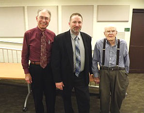 Coaster Photo - Acting Ocean Township Manager Gregory G. Fehrenbach (left) and former manager Fenton Hudson (right) greet new Township Manager Michael F. Muscillo at last week's Township Council meeting.