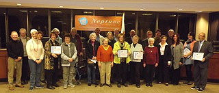 Coaster Photo - Neptune officials are pictured with members of Ocean Grove orgamizations. The historic district was designated as one of the greatest neighborhoods in the state.