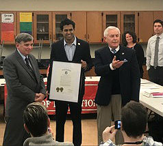 Sen. Vin Gopal presents William Folk, (left) with a Resolution from the State of NJ for his work as the Neptune City Board of Education Business Administrator for the last 25 years. Assemblyman Eric Houghtaling (right) also attended.
