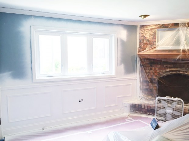 Wainscoting by fireplace