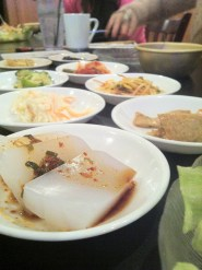 """The meal started with kimchi, fish cakes, and other Korean side dishes - all pretty good, very traditional."""