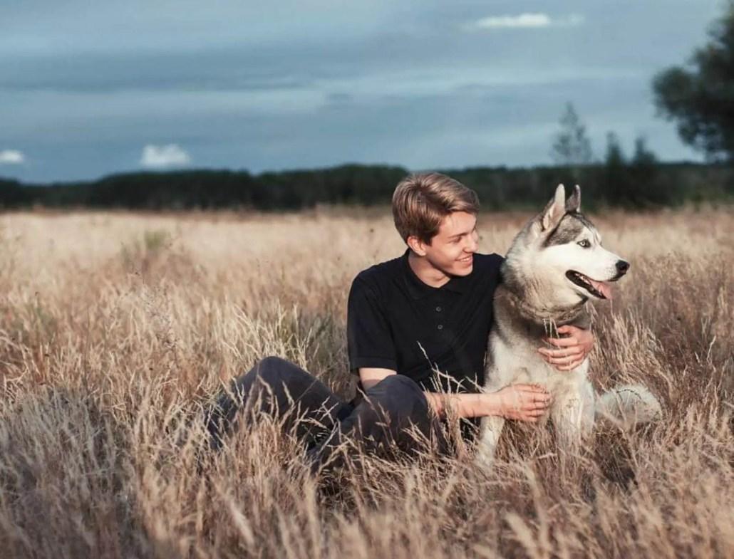 husky dog and happy owner dog training