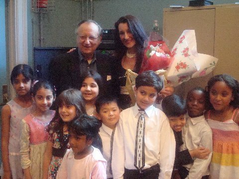 State Senator Frank Padavan with teacher Ms. Christine Passarella. He was touched by these precious children.