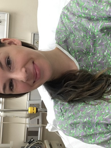 In hospital gown waiting for liver biopsy