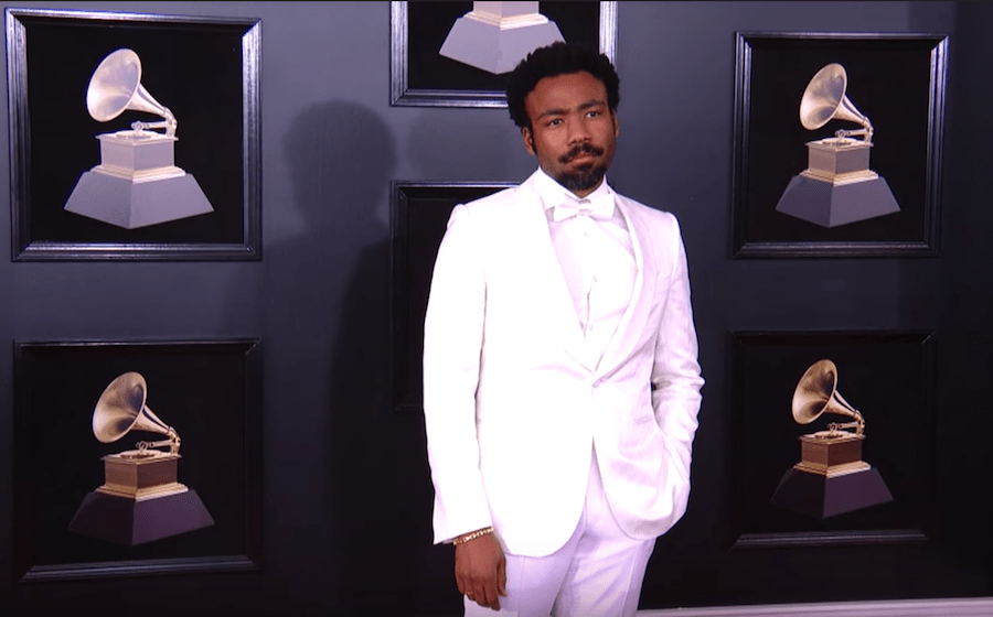 Donald Glover as Childish Gambino wins a Grammy Award and performs on the Grammys with his Lion King castmate