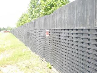 Sherrie Wilcox standing by FEMA coffins outside of Atlanta
