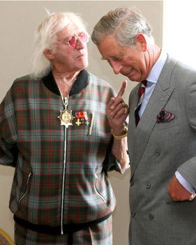 Known child sex trafficker, Jimmy Savile, and Prince Charles.