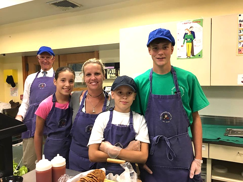 Family of Volunteers serving at the Community Kitchen