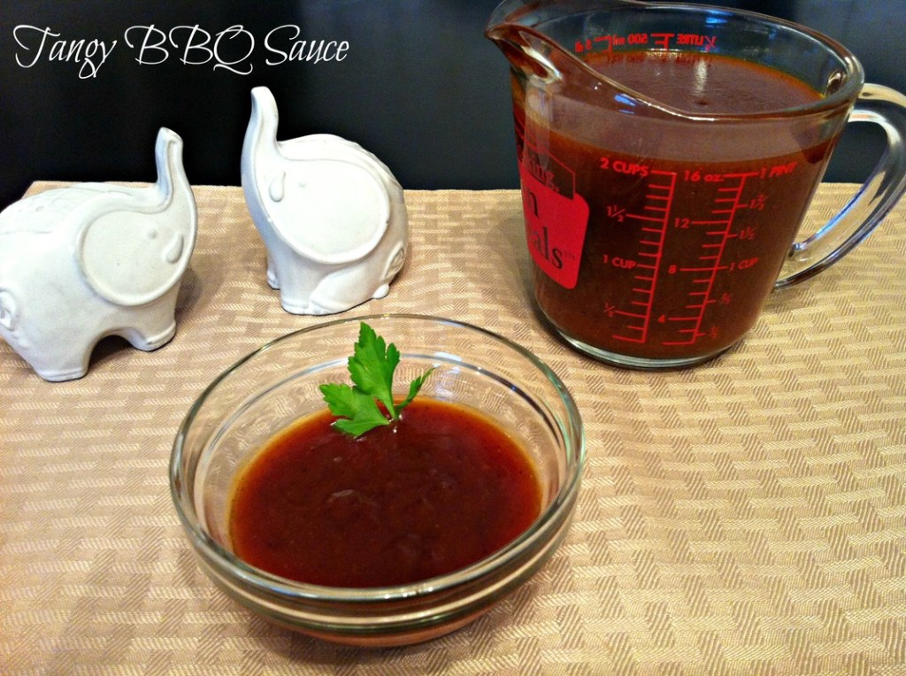 Measuring cup and glass bowl of homemade bbq sauce