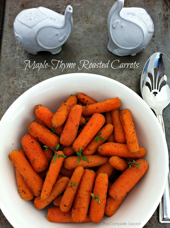 Maple Thyme Roasted Carrots ~ Delicious carrots roasted in real maple syrup and tossed with thyme, salt, and pepper make for the perfect side dish for any meal.