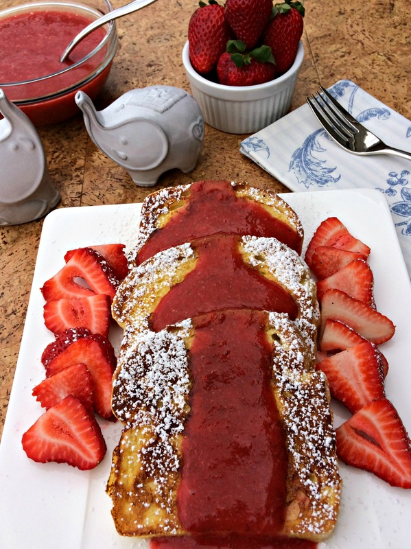 French Toast ~ Classic breakfast of seasoned egg battered bread and griddle-cooked, then topped with a delicious Strawberry Coulis ~ The Complete Savorist