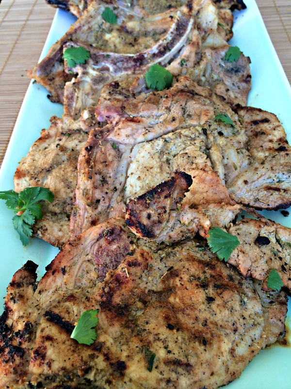 Grilled Cuban Pork Chops ~ Citrus and herb marinated pork chops, then spiced rubbed and grilled ~ The Complete Savorist