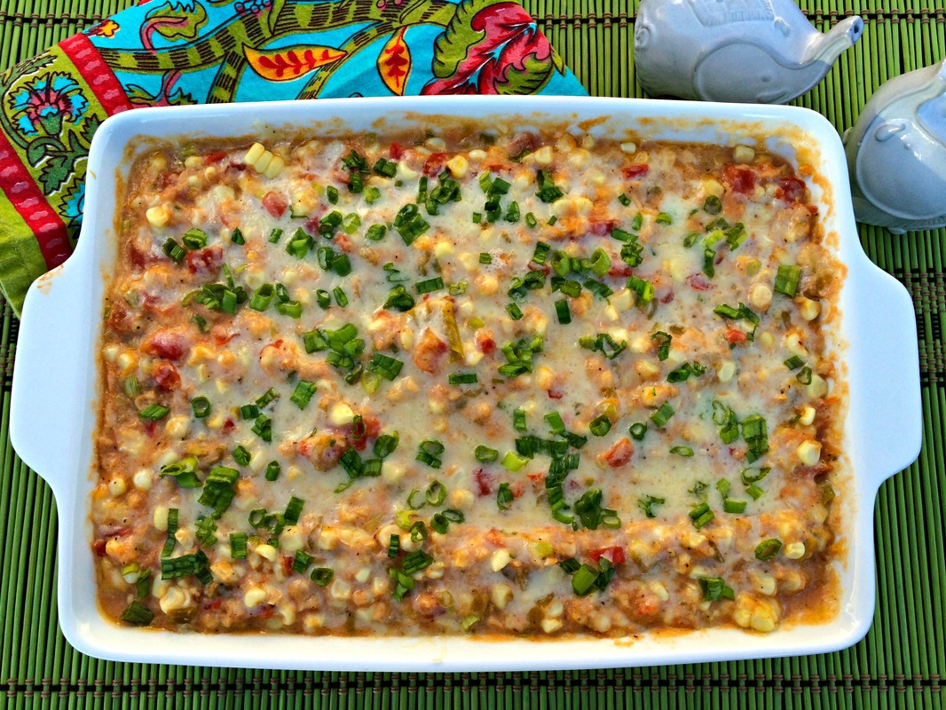 Green Chili Corn Dip ~ Fresh grilled corn, fire roasted green chilies, lots and lots of cheese make for one intensely amazing dip ~ The Complete Savorist