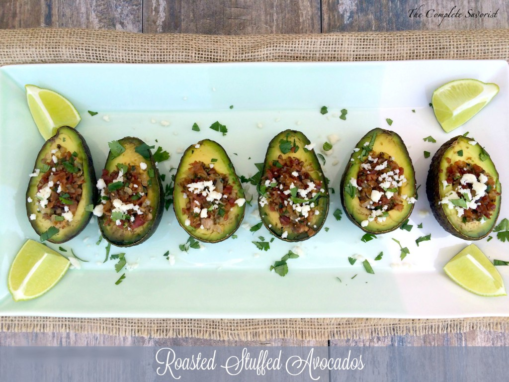 Roasted Stuffed Avocados ~ Bacon, mushrooms, jalapeños stuffed in an avocado, roasted and topped with queso fresco and cilantro ~ The Complete Savorist
