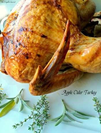 Apple Cider Turkey ~ Turkey roasted and steamed from the inside with freshly pressed apple cider and herbs using the Turkey Cannon makes a moist, fragrant, and delicious bird ~ The Complete Savorist by Michelle De La Cerda #campchef