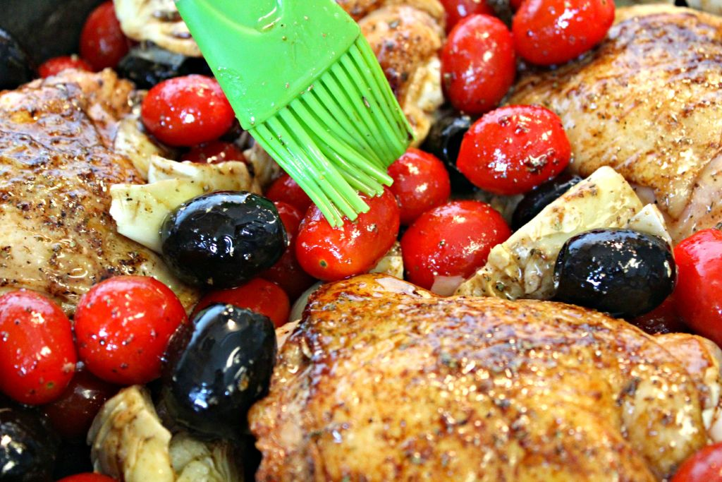 Brushing on the sauce for Mediterranean Chicken ~ The Complete Savorist #CalOlivesMedRecipe