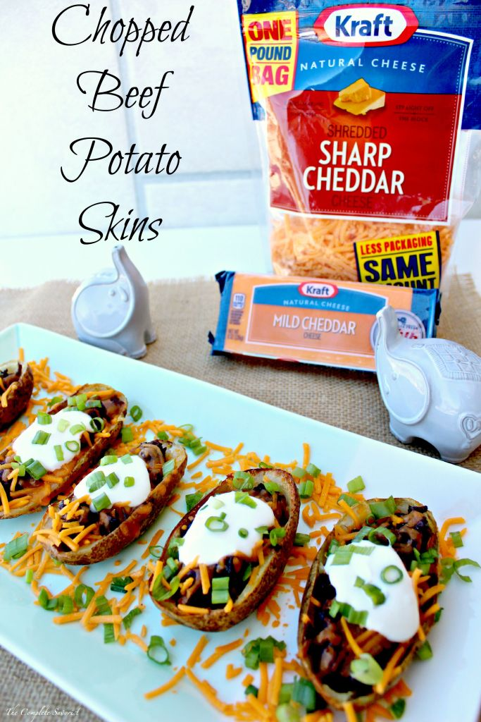 Chopped Beef Potato Skins ~ Slow cooked beef drenched in bbq sauce chopped and placed in a hallowed potato skin topped with sour cream, green onions, and cheese ~ The Complete Savorist #NaturallyCheesy #ad