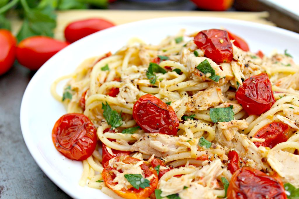 Spaghetti with Tuna and Roasted Tomatoes is pasta, garden roasted tomatoes, chunk white tuna, drizzled with olive oil, topped with cheese and fresh parsley.
