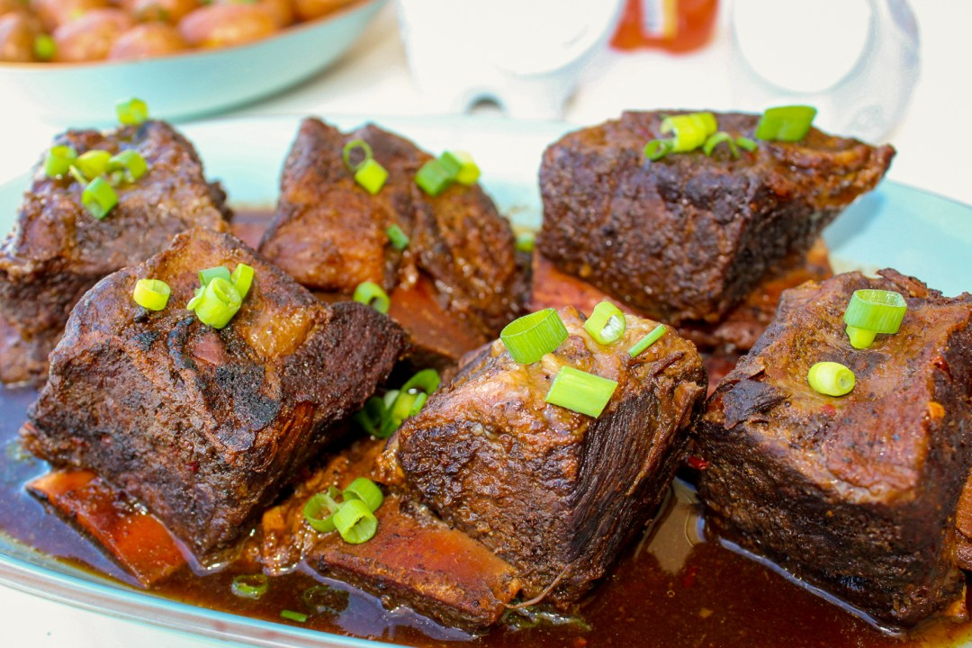 Close up view of short ribs in an Asian inspired sauce.