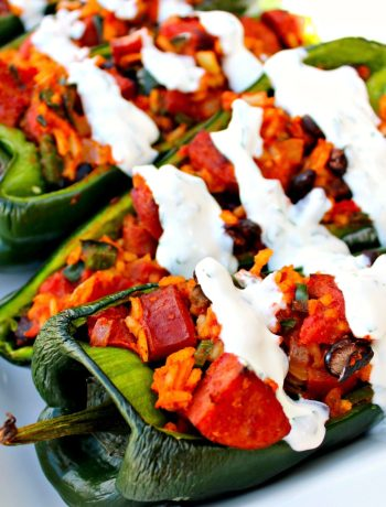 Sausage Stuffed Poblanos with Lime Crema ~ Black beans, polksa kielbasa, and Spanish rice stuffed into a poblano pepper, roasted and drizzled with a lime crema ~ The Complete Savorist #DeliciousDinners ad