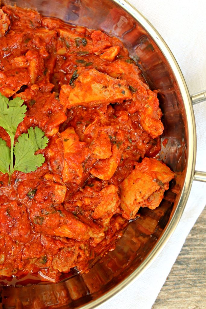 Indian Spiced Butter Chicken ~ Classic Indian chicken dish in a hearty spiced creamy tomato sauce of yogurt, cream, and ghee served with basmati rice ~ The Complete Savorist