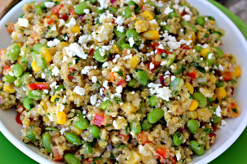Loaded Quinoa and Edamame Salad ~ Quinoa and Edamame in a red wine vinaigrette packed with corn, peppers, celery, onions, and feta cheese ~ The Complete Savorist