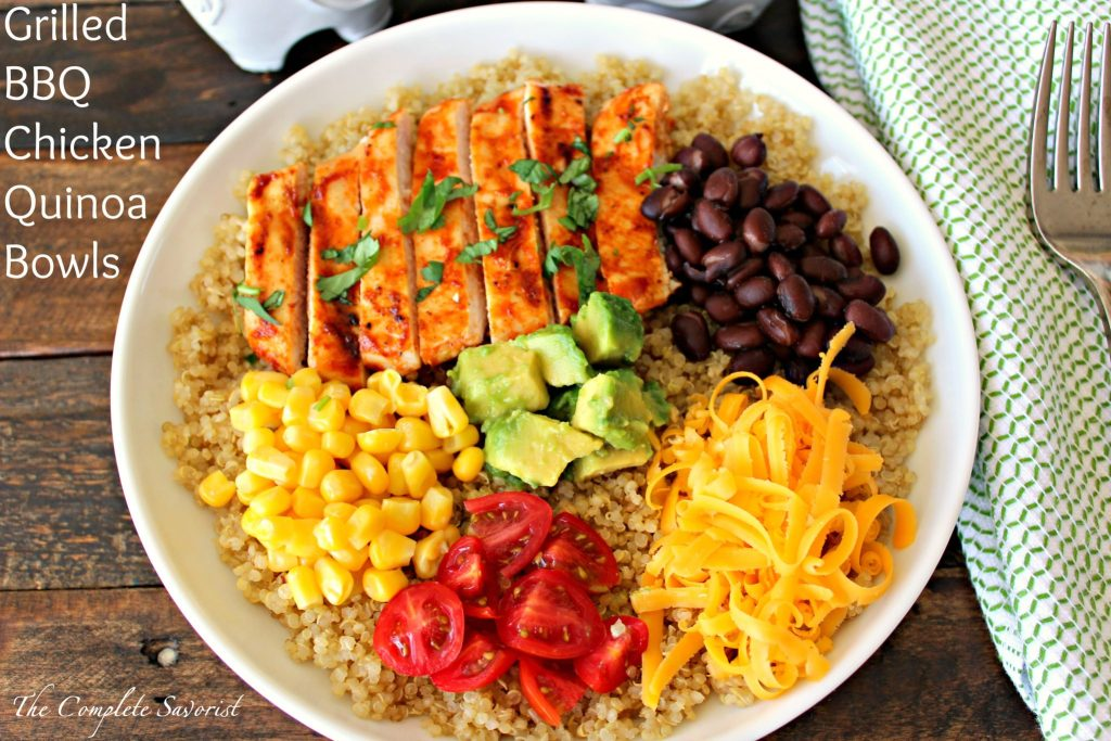 Grilled BBQ Chicken Quinoa Bowls ~ Grilled chicken slathered in homemade bbq sauce served over broth infused quinoa loaded with cheese, black beans, corn, tomatoes, and avocado ~ The Complete Savorist #BlockPartyHero ad