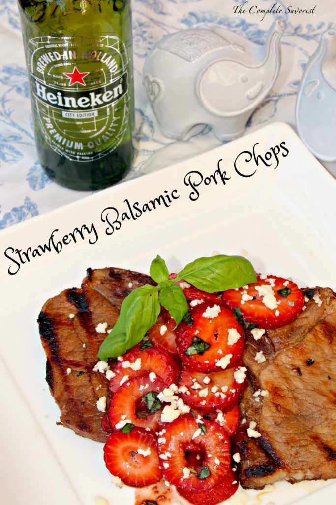 It truly was a perfect evening. The chops had been marinated in a balsamic vinegar based sauce. I love sweet and savory, as you all know, and the strawberries at the store were screaming red and luscious, so they were tossed with fresh basil picked right from Darla's herb garden and my homemade balsamic reduction. Spooned over the pipping hot, fresh grilled chops and topped with a generous sprinkling of bleu cheese, dinner was delicious. Coupled with an ice cold Heineken, we took a boring ole weeknight, and made it feel like a weekend, with very little effort.