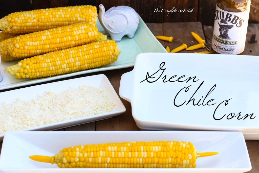 Green Chile Corn ~ Take that fresh corn on the cob and turn it on its ear by rolling it in spicy green chile sauce and crumbled cotija cheese ~ The Complete Savorist #StubbsInsider ad