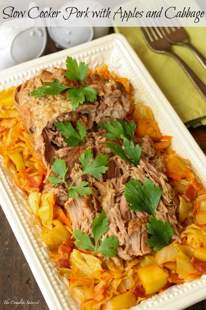 Slow Cooker Pork with Apples and Cabbage ~ Pork shoulder slow cooked in apple cider and herbs, served over sautéed cabbage and apples ~ The Complete Savorist #SmithfieldCares ad