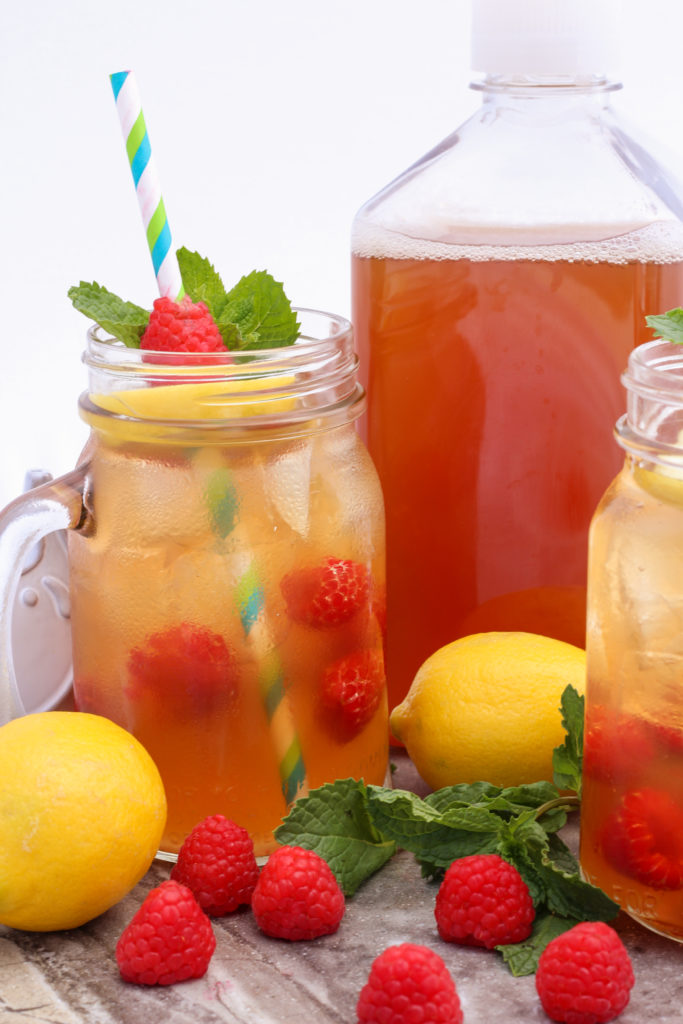 Raspberry Arnold Palmer ~ The classic lemonade and iced tea combo becomes a delightful trio when infused with fresh raspberries ~ The Complete Savorist by Michelle De La Cerda