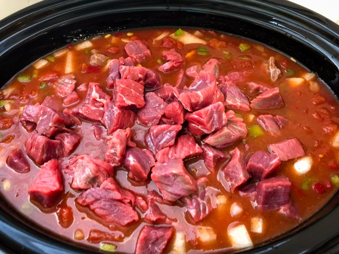 Cubed London Broil (top round) added to the slow cooker.