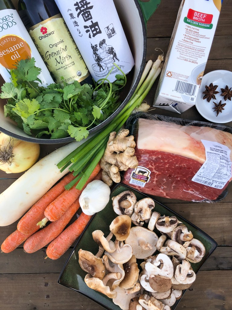 Ingredients to make Japanese inspired pot roast: Certified Angus Beef rump roast, mushrooms, carrots, daikon, garlic, ginger, green onions, yell onion, cilantro, sesame oil, mirin, soy sauce, beef broth, and star anise.