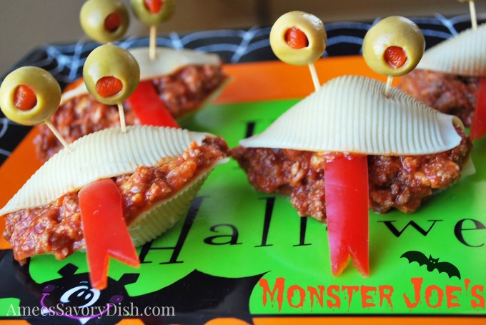 Sloppy joes stuffed pasta shells with green olive eyes and a pepper tongue for Halloween