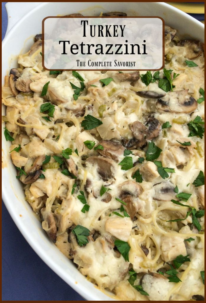 The fully baked turkey tetrazzini in a white casserole pan.