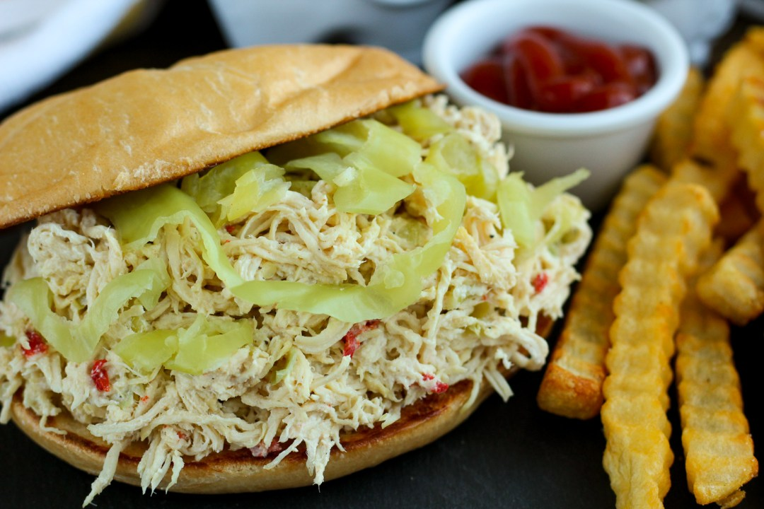 Close of view of the shredded chicken sandwich with french fries