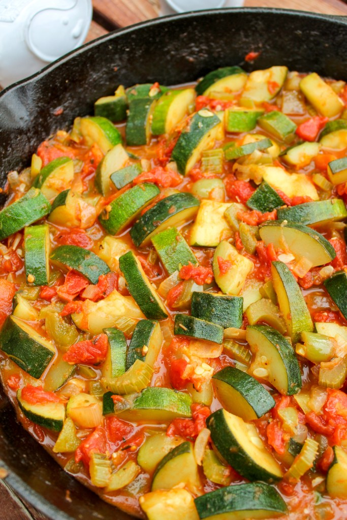 Close up the vegetables in a cast iron skillet.