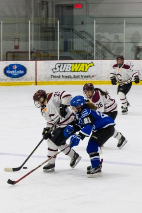 Keriann Schofield fights off a Carabins player during the Stingers loss. Photo by Kelsey Litwin.