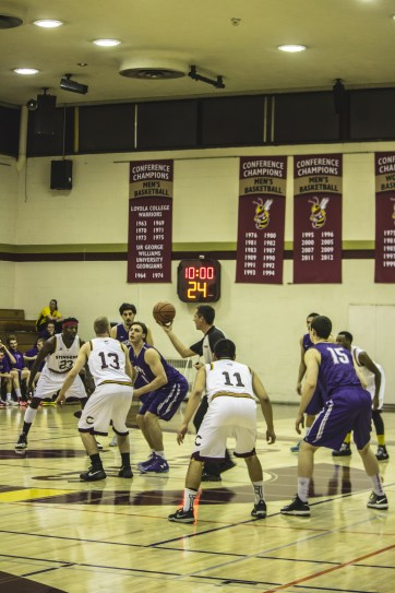 The Stingers men's basketball team goes for the ball off of the opening jump ball. Photos by Melissa Martella.