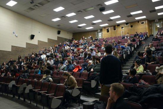 Audience members in the Frank Adams Auditorium on McGill University. Photo by Elisa Barbier.